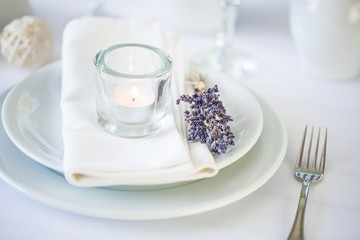 Setting. Dining table setting at Provence style, with candles