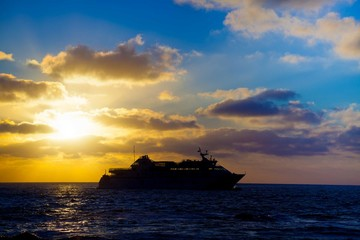 tourist liner in the sea at sunset