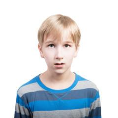 Studio portrait of a surprised preteen boy, white background