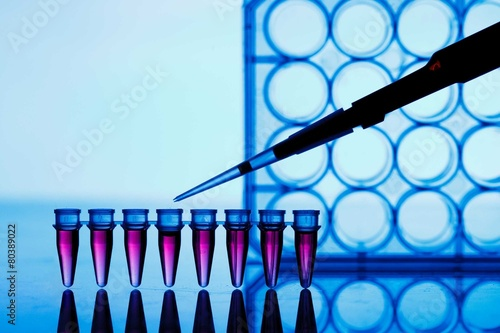 Leinwanddruck Bild PCR strip test tubes and micropipette in genetics laboratory