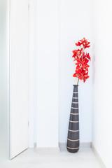 Red flowers in brown vase