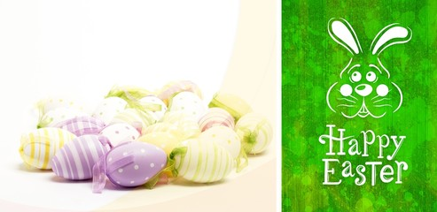Composite image of easter bunny with greeting