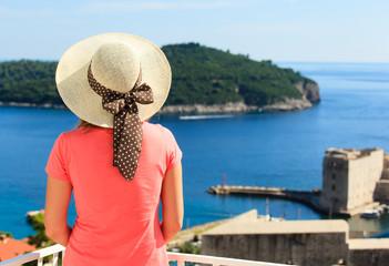 young woman enjoying view of Dubrovnik