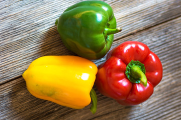 Colorful peppers on wooden background