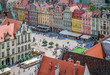 People walking on the market square in Wroclaw, Poland. - 80390098