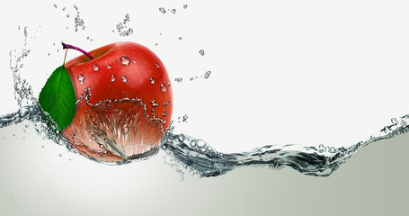Red,juicy Apple in a spray of water.
