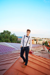 Handsome  hipster guy on the roof
