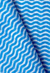 blue napkin in white wavy stripes