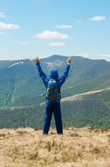 Tourist, man and success in mountains, arms raised. Running