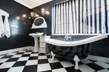 Black and white bathtub in bathroom