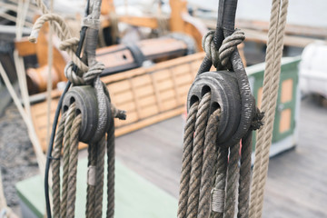 Wooden sailboat pulleys and ropes detail
