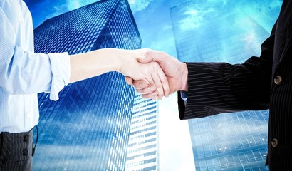 Composite image of close up of a business people closing a deal
