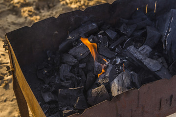 fire burning coals in the grill for barbecue