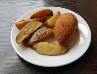 fried cutlet and baked potato