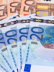 Several banknotes of euro lying on the table