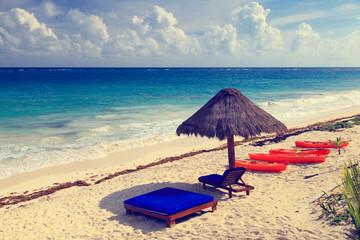 Beach chairs in luxury resort on carribean coast