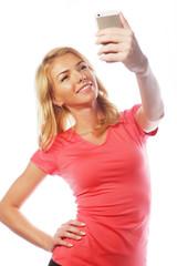 sporty blond woman making selfie