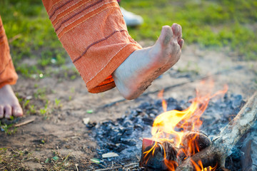 foot in the fire
