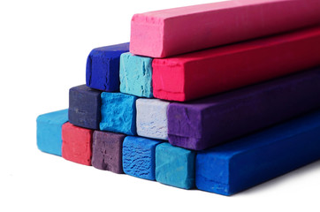 Art objects background - red,blue,violet and purple crayons