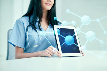 close up of doctor showing molecules on tablet pc