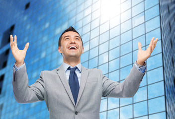 happy laughing businessman in suit