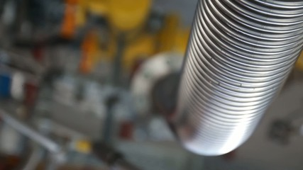 Trembling corrugated pipe on the equipment