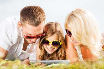 happy family with tablet pc taking picture