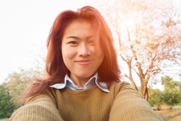 happy women take selfie photo at sunset