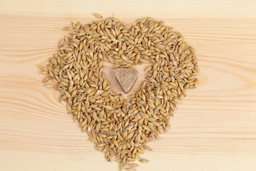 One sugar heart next to wheat - concept of love