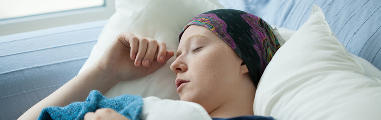 Woman with cancer resting in bed