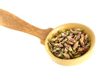 spring black currant bush  vitamin healthy buds in wooden spoon