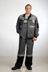 Man posing in overalls.isolated studio portrait