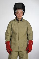 Man posing in overalls.isolated studio portrait