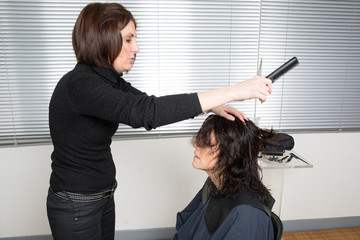 Woman cutting clients hair at the beauty salon