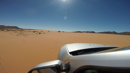 Driving on sand dunes with a 4wd car. Morocco, Africa.
