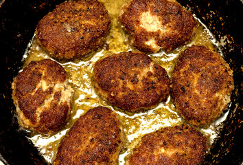 cooking meat cutlets in a frying pan