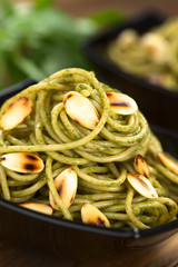 Pasta with pesto made of basil and spinach with roasted almond