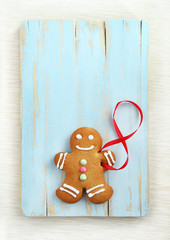 Image of Gingerbread man on blue vintage cutting board