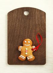 Image of Gingerbread man on brown cutting board