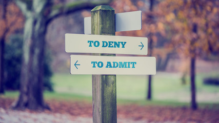 Sign Post Pointing Toward Choices in Honesty