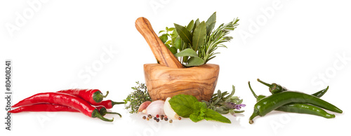 Wooden mortar with herbs on white background - 80408241