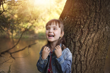 Joyful girl laughing in the sunny park