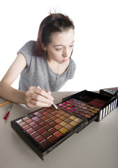 Young Woman Applying Make Up from Large Palette