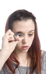 Teenage Girl Curling Eyelashes with Eyelash Curler