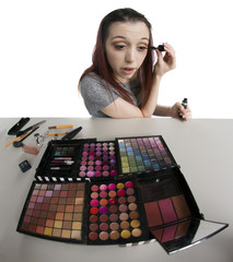 Young Woman with Tray of Make Up Applying Mascara