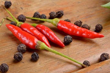 Cayenne and black pepper on wood