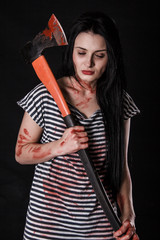 Young woman with a big bloody axe
