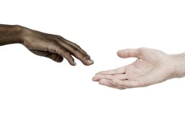 Interracial hands reaching each other