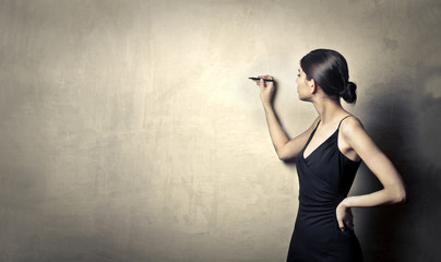 Woman writing on a wall