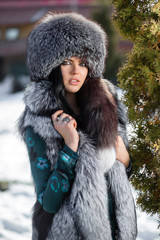 Beautiful young girl in a fur hat